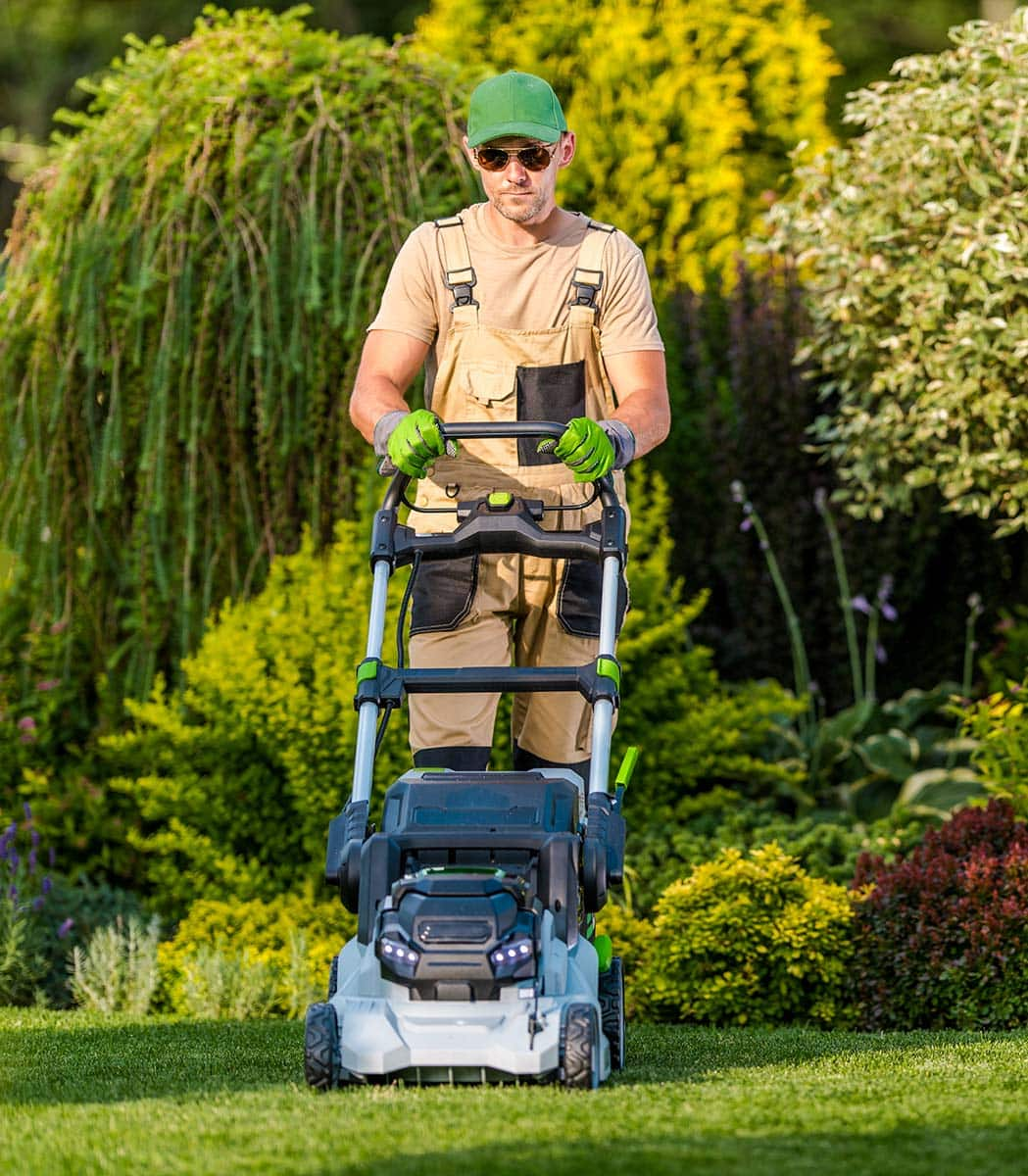 Man Mowing Lawn in Galesburg IL