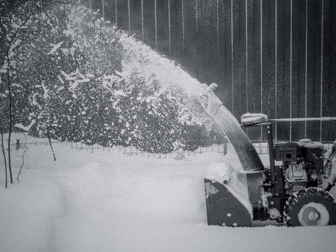 Snowblower at work on a winter day